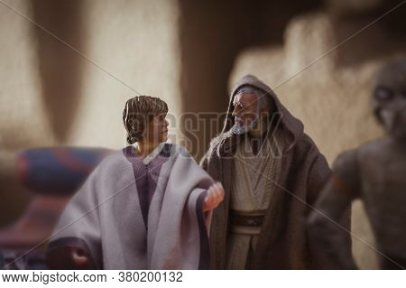 AUGUST 2 2020: recreation of a scene from Star Wars A New Hope where Luke Skywalker and Obi Wan Kenobi are at Mos Eisley spaceport - Hasbro action figure