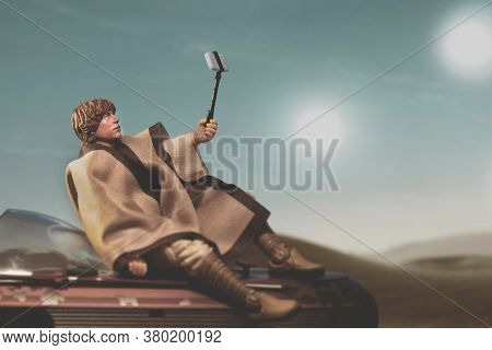 AUGUST 2 2020: a humorous scene from Star Wars A New Hope where Luke Skywalker takes a selfie on Tatooine - Hasbro action figure