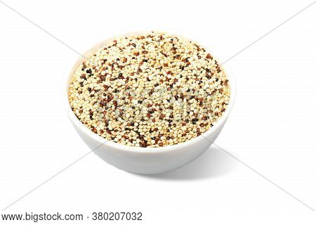 Bowl Full Of Quinoa Grains Isolated On White Background
