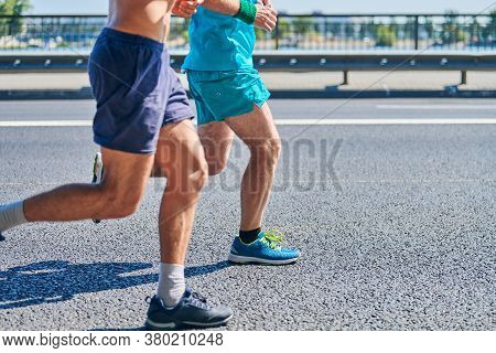 Running Men. Sport Men Jogging In Sportswear On City Road. Healthy Lifestyle, Fitness Hobby. Street