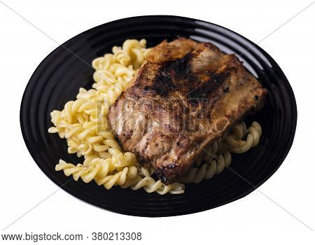 Grilled Pork Ribs With Pasta. Grilled Pork Ribs On Black Plate Isolated On White Background. Grilled