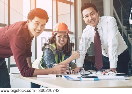 Success Contractor Team With Engineer And Architect Having A Successful Meeting.