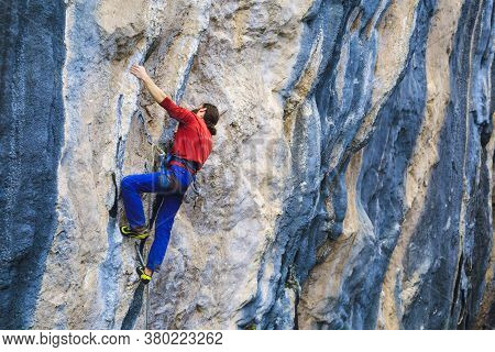 A Strong Man Climbs A Rock, Rock Climbing In Turkey, Training Endurance And Strength, Man In Extreme