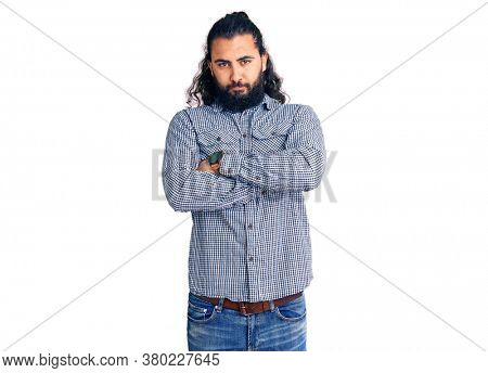 Young arab man wearing casual clothes skeptic and nervous, disapproving expression on face with crossed arms. negative person.