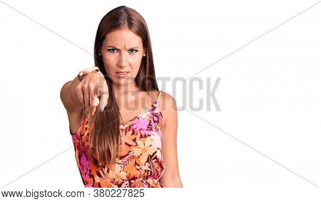 Young beautiful hispanic woman wearing casual clothes pointing displeased and frustrated to the camera, angry and furious with you