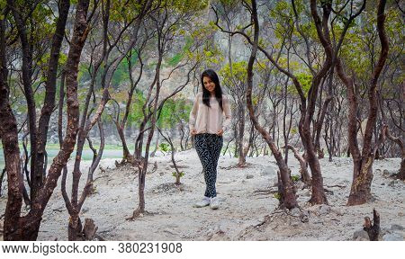 An Asian Indonesian Female Standing In The Woods Of A Volcanic Crater Lake, Bandung, Indonesia