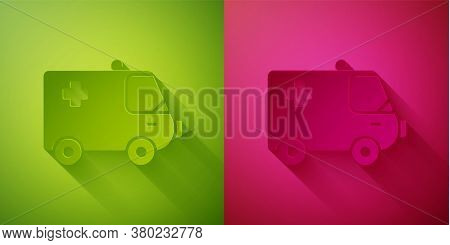 Paper Cut Ambulance And Emergency Car Icon Isolated On Green And Pink Background. Ambulance Vehicle