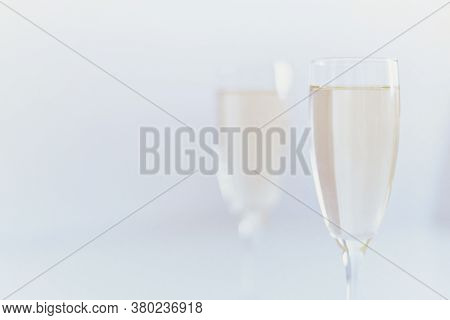 Two Glasses Of Champagne With Bottle. Romantic Date Or Celebration Anniversary. Couple Alcohol Drink