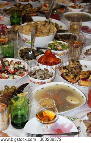 Holiday Table Setting. Festive Table With Delicious Dishes. Many Food On Table For Family Holiday. F