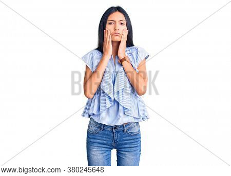 Young beautiful latin girl wearing casual clothes tired hands covering face, depression and sadness, upset and irritated for problem