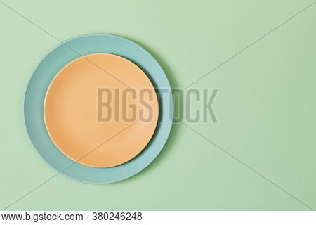 Top View Of Empty Plates And Napkin Isolated On Green, Copy Space. Table Setting. Celebration Concep