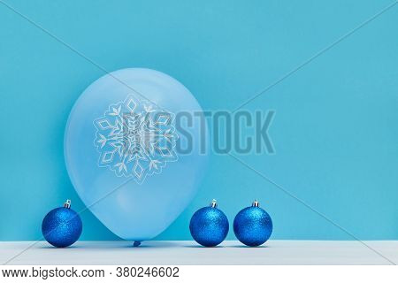 Balls For Decoration And Air Balloon With Pattern. Bright Glitter Balls. New Year. Xmas. Copy Space.