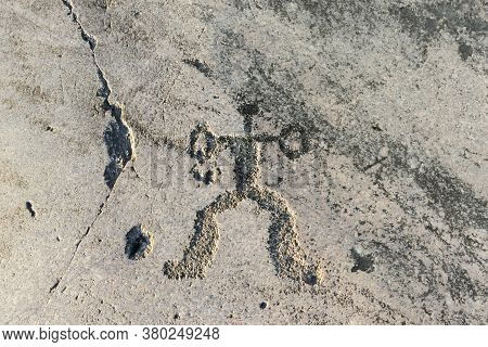 Prehistoric Rock Carving On The Granite Shore Of The Lake. Anthropomorphic Ornament Close-up - Fragm