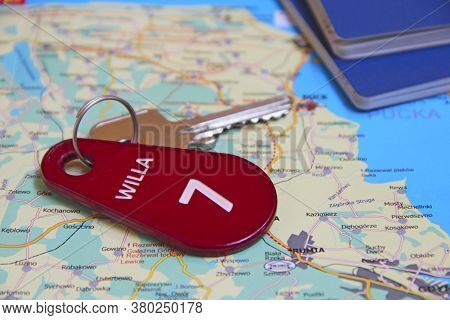 Key From Room Number Seven Passports And Map For Travelling. Travel Concept. Things Collected For Va