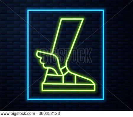 Glowing Neon Line Hermes Sandal Icon Isolated On Brick Wall Background. Ancient Greek God Hermes. Ru