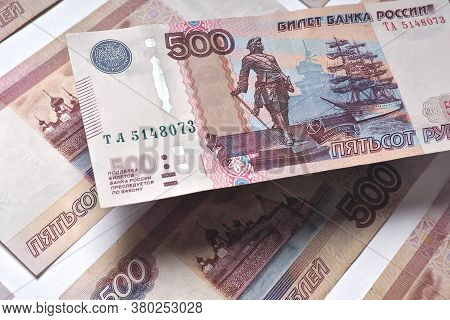 A Russian Bill Of Five Hundred Rubles Hangs Above The Surface From The Same Banknotes. Showing Both
