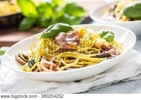 Italian Pasta Spaghetti Prosciutto Mushrooms Parmesan And Olive Oil.