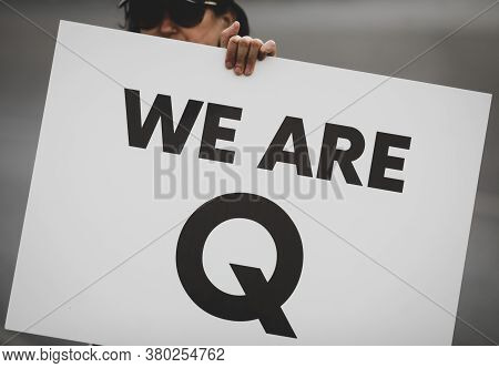 Bucharest, Romania - August 10, 2020: A Woman Takes Part At A Protest And Displays A Qanon Message O
