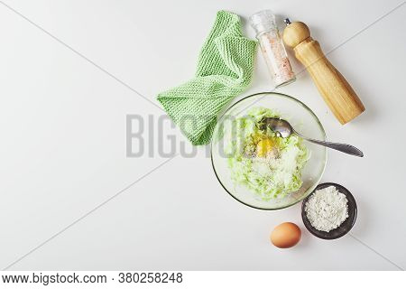 Ingredients For Cooking Zucchini Pancakes Or Fritters - Grated Zucchini, Egg, Flour. Top View, Place
