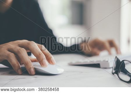 Closeup Businessman Using Computer Mouse With Computer Keyboard