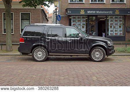 Medemblik, The Netherlands - July 22, 2020: Black Lincoln Navigator Parked By The Side Of The Road.