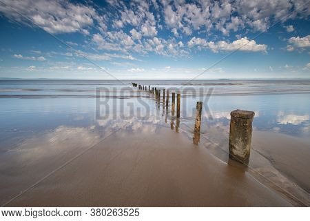 Groynes In The Sand & Sea At Burnham On Sea, Somerset