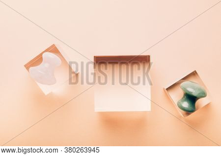 Green Aventurine And Rose Quartz Gua Sha Mushrooms For Beauty Facial Massage Therapy On Clear Displa