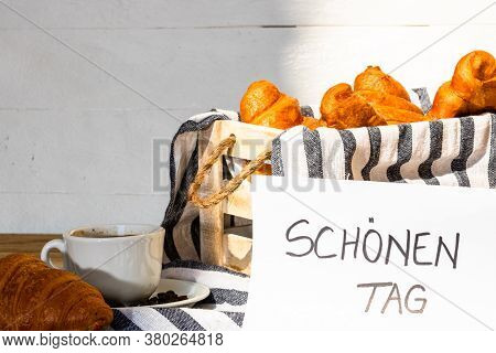 Coffee Cup And Buttered Fresh French Croissant On Wooden Crate. Food And Breakfast Concept. Morning