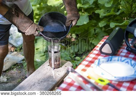 Person Pouring Hot Water Into A Coffee French Press While Camping