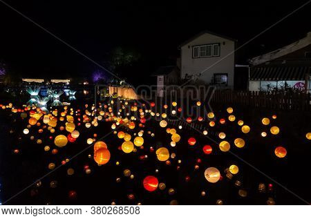 Tainan City, Taiwan - Feb 3rd, 2020: Yuejin Lantern Festival, lanterns decoration hanging over the river at night during the Chinese New Year with crowd at Yanshui, Tainan, Taiwan