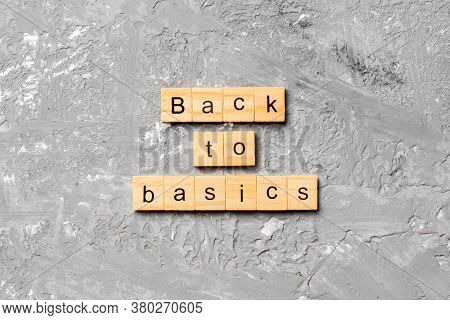 Back To Basics Word Written On Wood Block. Back To Basics Text On Table, Concept