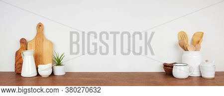Kitchenware And Utensils On A Wood Shelf Or Countertop. Banner With A White Wall Background And Copy