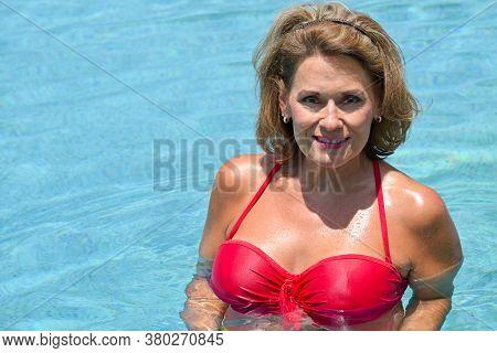Beautiful Mature Woman In The Swimming Pool