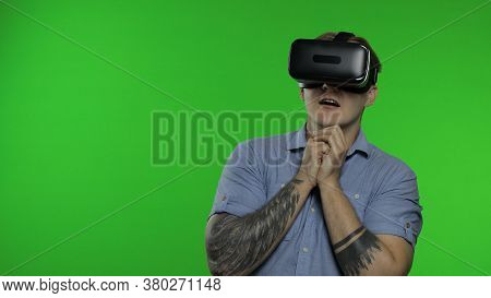 Man Using Vr App Headset Helmet To Play Scary Simulation Game. Watching Virtual Reality 3d 360 Video