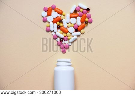 Medical Concept. Assorted Of Pharmacological Preparations, Pills And Pills In The Shape Of A Heart F
