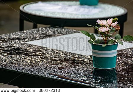 The Tables In The Cafe Are On The Street. Raindrops On The Table After The Cafe.