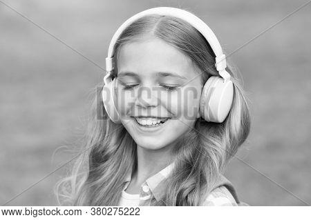 Listen Music While Walking. Girl Headphones Listening Music. Educational Podcast. Kid Girl Enjoy Mus