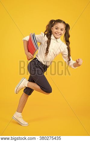 Back To School. Kid Cheerful Schoolgirl Running. Pupil Want Study. Active Child In Motion. Beginning
