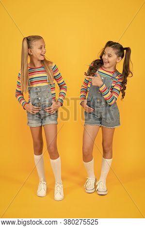 Little Girls Yellow Background. Hairdresser Salon. Kid Summer Fashion. Beauty And Style. Childhood H