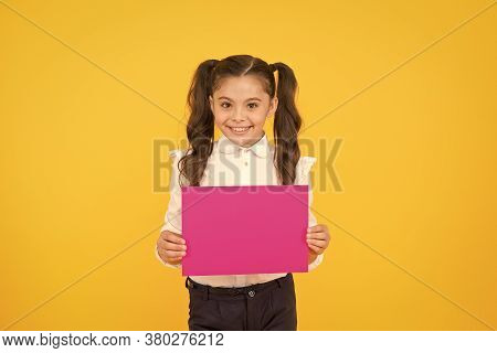 Upcoming Event. Look Here. Girl School Uniform Hold Poster. Schoolgirl Hold Poster Copy Space. News