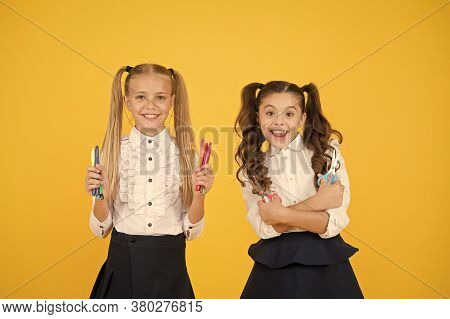 Crafts For Elementary School Kids. Schoolgirls Classmates Hold School Stationery Supplies For Crafts