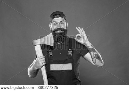 Forester Hold The Ax. Man In Uniform Cut Beard Hair With Ax. Brutal Bearded Man Use Axe. Hike Vacati