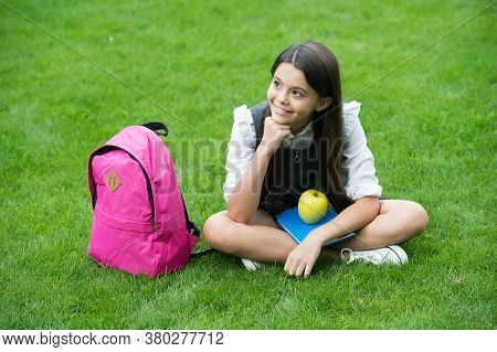 Education That Inspires. Happy Kid Relax On Green Grass. School Break. Fruit Snack. Health Education