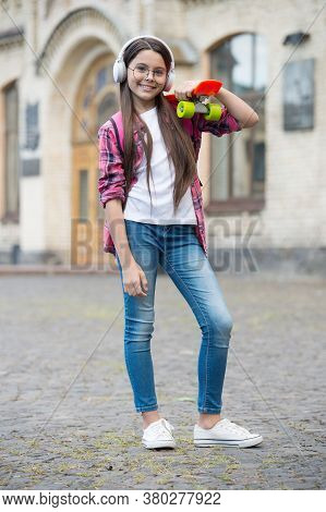 Mix Vacation With Urban Roll. Happy Child Hold Penny Board Outdoors. Skateboarding. Skate Trip. Free