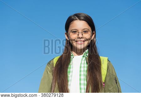 Frame Designed For Comfort And Style. Happy Girl Wear Glasses On Blue Sky. Kids Glasses. Corrective