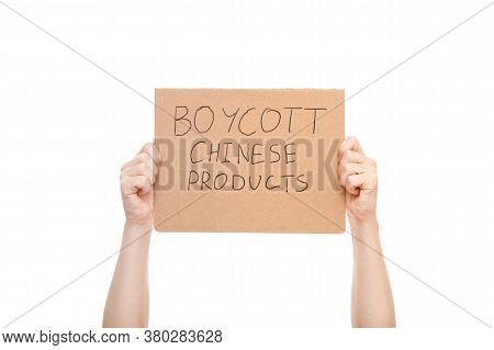 Protest Poster In The Hands Of A Faceless Man With A Message To Boycott Chinese Products, Cardboard