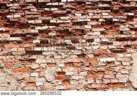 The Texture Of Old Red Brickwork, Broken Pieces Of Brick From Time.