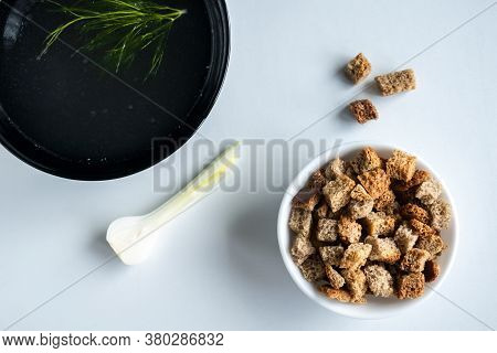 Homemade Meat Bone Broth In A Bowl With Dill, Onions And Croutons. On A White Background. Healthy Fo