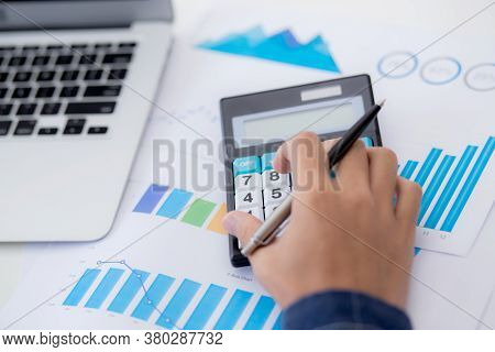 Hand Of Young Asian Business Man Working Using Calculator For Planning Accountant, Graph For Finance