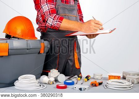 Electrician Signs A Work Contract. Worker Draws Up A Work Plan.